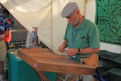 USA, AZ: Playing an Old-time Hammered Dulcimer Stock Photography