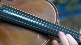 Playing the old  violin stock video