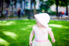 Playing Outdoors With Soup Bubbles Royalty Free Stock Photography