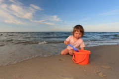 Playing over sea. Little girl playing on the beach Royalty Free Stock Photography