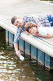 Playing with paper boat together. Royalty Free Stock Images