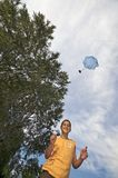 Playing with parachute toy vertical Royalty Free Stock Images
