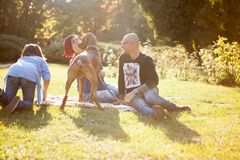 Playing in the park with their dog. Animal lovers. Mother, father, daughter and their dog Stock Image