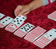 Playing patience card game. Stock Images