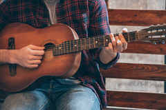 Playing perfect chord. Royalty Free Stock Photo