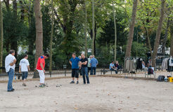 Playing petanque in the late afternoon in Luxemburg Garden in Paris Royalty Free Stock Photo