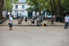 Playing petanque in the late afternoon in Luxemburg Garden in Paris Royalty Free Stock Image