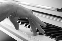 Playing Piano 1. Closeup on a hand playing the piano Royalty Free Stock Photo
