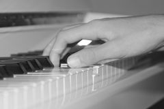 Playing the piano. Someone playing the piano. Black and white photo Stock Photo