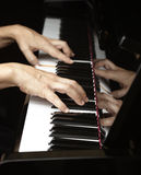 Playing piano Stock Image