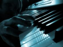 Playing piano. Close up of men playing piano Stock Photo