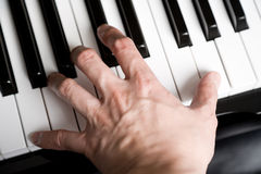 Playing a piano Stock Photos