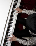 Playing the piano Royalty Free Stock Photos