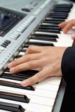 Playing the piano. Stock Image
