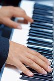 Playing the piano. Royalty Free Stock Photos