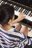 Playing piano Royalty Free Stock Image