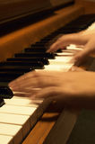 Playing The Piano. A musician's hands in blur-motion while playing the piano Royalty Free Stock Photo