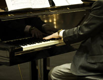 Playing the Piano. Pianist playing the grand piano Stock Images