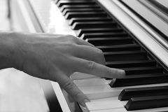 Playing Piano 3. Closeup on a hand playing the piano Royalty Free Stock Image