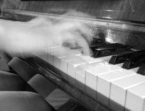 Playing the Piano. Shallow DOF stock photo