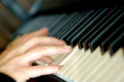 Playing Piano. Photo of a men playing piano royalty free stock photo
