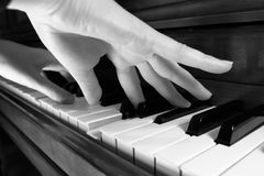 Playing the Piano. Two hands playing the piano, converted to BW.  Shallow DOF used Royalty Free Stock Image