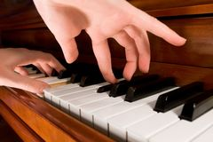 Playing the Piano. Two hands playing the piano, selective focus stock photos