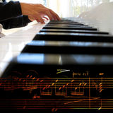 Playing piano. Collage of music notes and white piano Royalty Free Stock Photos