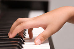Playing piano. A person getting ready to play the piano.  This is a close up of the hands Royalty Free Stock Photography