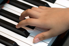 Playing piano. A person getting ready to play the piano.  This is a close up of the hands and view from the top Stock Photo