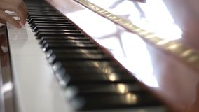 Playing piano with both hands stock video footage