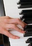 Playing the piano, a child Royalty Free Stock Image