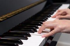 Playing piano 1 Royalty Free Stock Photos