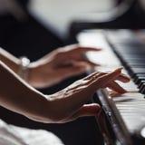 Playing piano Stock Photo