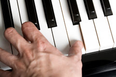 Playing a piano stock image