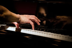 Playing piano at concert, focus on right hand, close up at low l stock photos