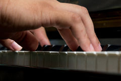 Playing piano. Detail pictures of somebody hand on piano Stock Photos