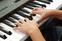 Playing piano and hand. Stock Photo