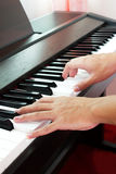 Playing piano and hand. Stock Images