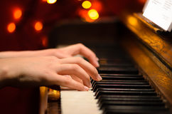 Playing piano. With hands detail Stock Images