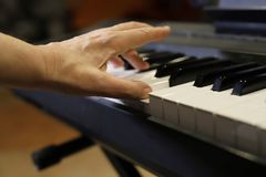 Playing the piano, hands playing piano stock photo