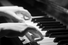 Playing on piano keyboard Royalty Free Stock Photo