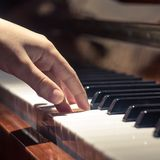 Playing on piano keyboard Stock Photography