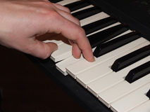 Playing piano with left hand Royalty Free Stock Image
