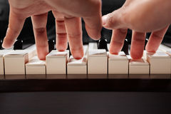 Playing piano from low angle Royalty Free Stock Image