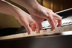 Playing piano from low angle Royalty Free Stock Photos