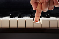 Playing piano from low angle Stock Photography