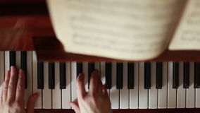 Playing The Piano in Motion stock footage