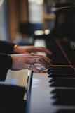 Playing the piano. Musician Playing the piano in a hall library korea stock images