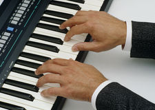 Playing piano-organ Stock Images